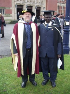 Joseph Mendy (right) and the head, School of education, Prof. Clive Harber in front of the Great Hall - Aston Webb Building, University of Birmingham